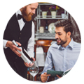 Segmentation customers restaurants man offering wine to a customer